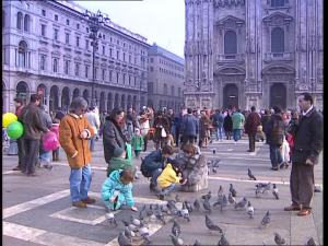 669607043-piazza-del-duomo-pigeon-feeding-animal-care-milan